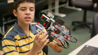 Boy with robotics model